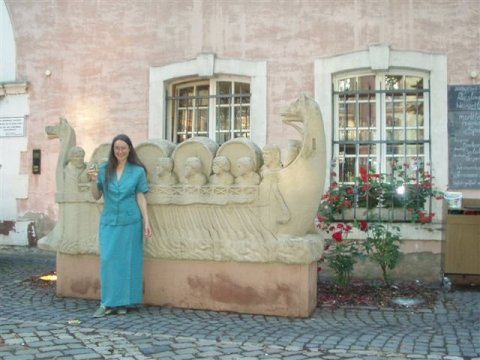 In 2005, Paul and Louisa joined the Hadrianic Society's Study Tour of Roman Germany. Louisa is seen here in Trier, at one time capital of the western Roman Empire and so the seat of government for the provinces of Britain. Louisa is sampling the principal export of the area. Wine beakers from the Trier region are found at Roman forts, such as Binchester, in the north of England, showing trade contact between the two areas. Wool from Britain may have been traded in exchange for wine.
