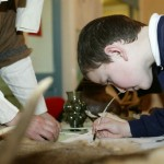 Children having a go at writing with quill pens Photos Copyright © NEMLAC